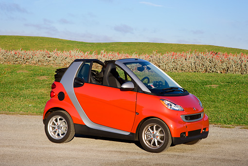 AUT 44 RK0094 01 © Kimball Stock 2009 Smart Fortwo Passion Cabriolet Red And Silver 3/4 Front View On Pavement By Field