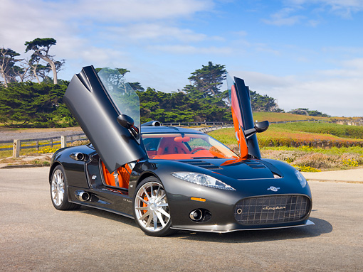 AUT 44 RK0104 01 © Kimball Stock 2009 Spyker C8 Aileron Gray 3/4 Front View On Pavement By Field And Trees