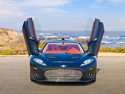 AUT 44 RK0113 01 © Kimball Stock 2009 Spyker C8 Aileron Gray Front View On Pavement By Ocean