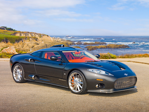 AUT 44 RK0115 01 © Kimball Stock 2009 Spyker C8 Aileron Gray 3/4 Front View On Pavement By Ocean