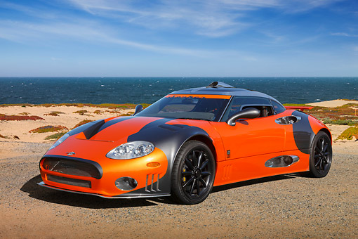 AUT 44 RK0129 01 © Kimball Stock 2009 Spyker C8 Laviolette LM85 Orange And Black 3/4 Front View On Sand By Ocean