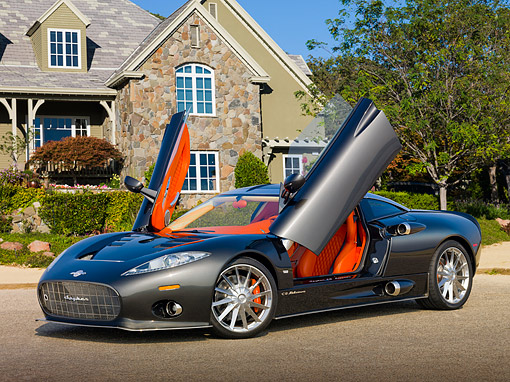 AUT 44 RK0130 01 © Kimball Stock 2009 Spyker C8 Aileron Gray 3/4 Front View On Pavement By House
