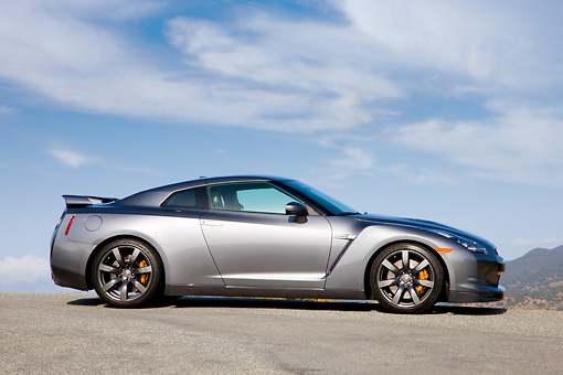 AUT 44 RK0012 01 © Kimball Stock 2009 Nissan GT-R Gray Profile View Blue Sky