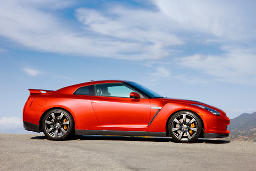 AUT 44 RK0015 01 © Kimball Stock 2009 Nissan GT-R Red Profile View Blue Sky