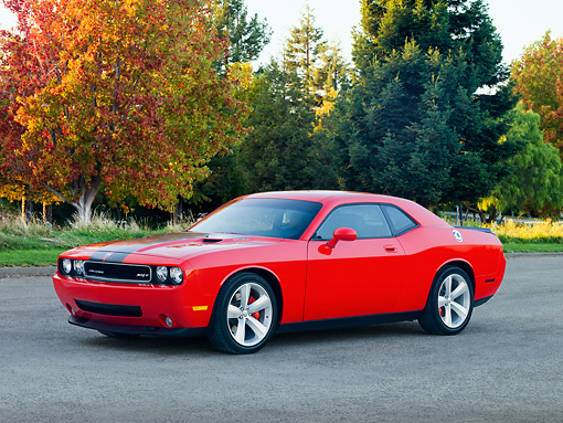 AUT 44 RK0017 01 © Kimball Stock 2009 Dodge Challenger SRT8 Limited Edition Red Black Stripe 3/4 Front View On Pavement By Trees