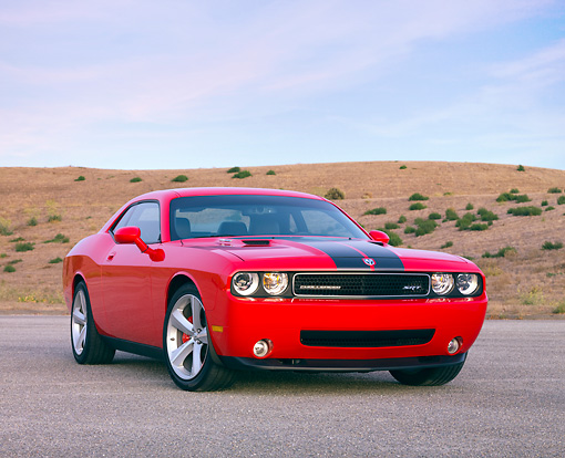 AUT 44 RK0022 01 © Kimball Stock 2009 Dodge Challenger SRT8 Limited Edition Red Black Stripe 3/4 Front View On Pavement By Hills