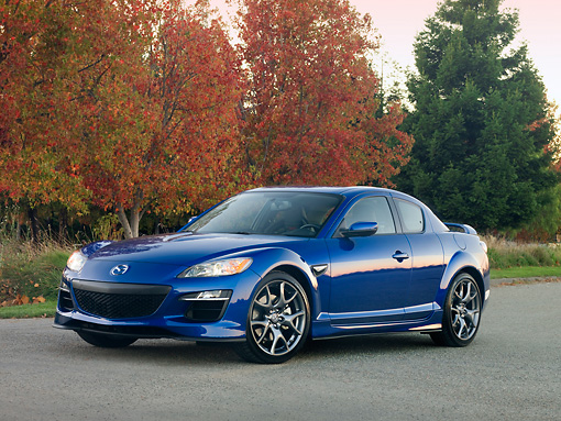 AUT 44 RK0024 01 © Kimball Stock 2009 Mazda RX-8 R3 Coupe Blue 3/4 Front View On Pavement By Trees