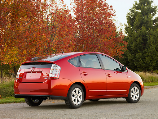 AUT 44 RK0029 01 © Kimball Stock 2009 Toyota Prius Red 3/4 Rear View On Pavement By Autumn Trees