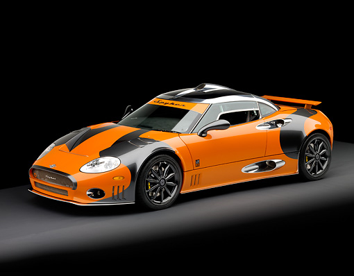 AUT 44 RK0033 01 © Kimball Stock 2009 Spyker C8 Laviolette LM85 Orange And Black 3/4 Front View Studio