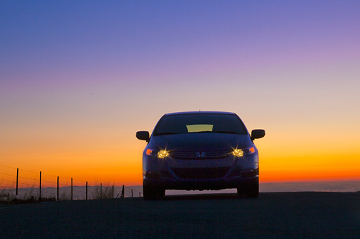 AUT 45 BK0001 01 © Kimball Stock 2010 Honda Insight Blue Front View On Pavement With Sunset