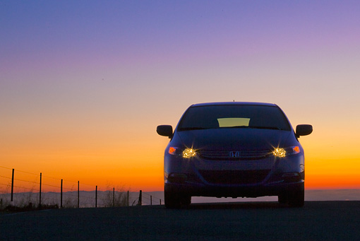 AUT 45 BK0002 01 © Kimball Stock 2010 Honda Insight Blue Front View On Pavement With Sunset