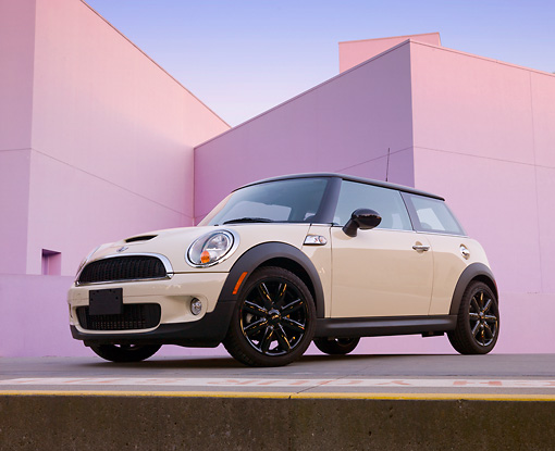 AUT 45 BK0010 01 © Kimball Stock 2010 Mini Cooper S White 3/4 Front View On Concrete By Structure