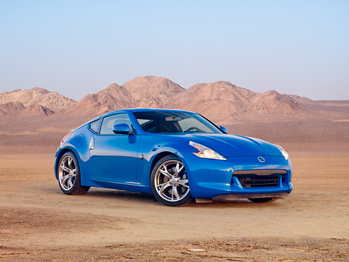 AUT 45 RK0018 01 © Kimball Stock 2010 Nissan 370Z Touring Blue 3/4 Front View In Desert