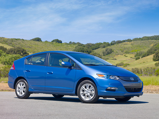 AUT 45 RK0021 01 © Kimball Stock 2010 Honda Insight Hybrid Blue 3/4 Front View On Pavement By Hills