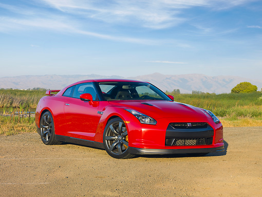 AUT 45 RK0045 01 © Kimball Stock 2010 Nissan GT-R Red 3/4 Front View On Dirt By Field