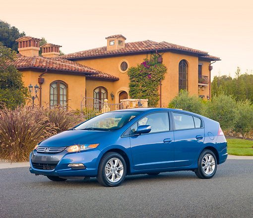 AUT 45 RK0046 01 © Kimball Stock 2010 Honda Insight Blue 3/4 Front View On Pavement By House