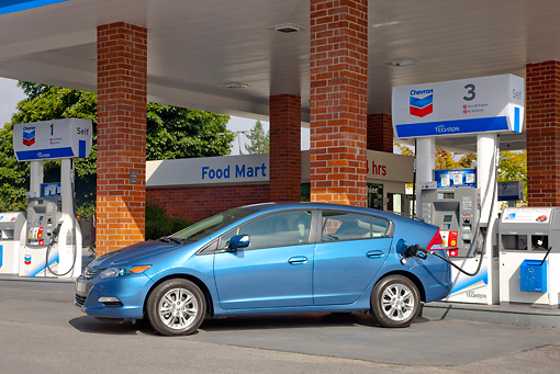 AUT 45 RK0053 01 © Kimball Stock 2010 Honda Insight Blue Profile View At Gas Station