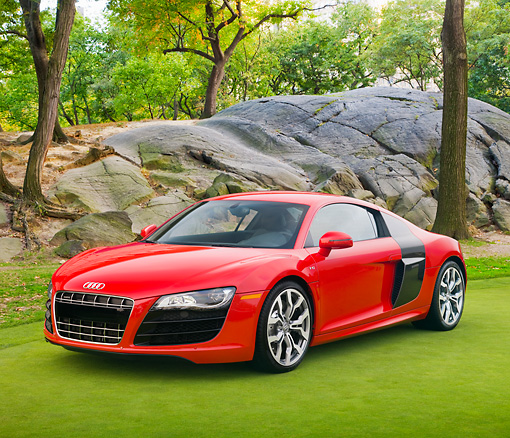 AUT 45 RK0064 01 © Kimball Stock 2010 Audi R8 5.2 FSI Quattro Red 3/4 Front View On Grass