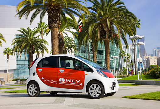 AUT 45 RK0006 01 © Kimball Stock 2010 Mitsubishi i MiEV White And Red 3/4 Front View On Pavement By Palm Trees
