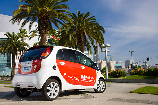 AUT 45 RK0008 01 © Kimball Stock 2010 Mitsubishi i MiEV White And Red 3/4 Rear View On Pavement By Palm Trees