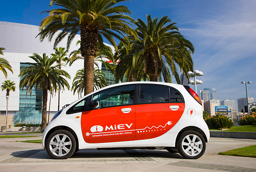 AUT 45 RK0010 01 © Kimball Stock 2010 Mitsubishi i MiEV White And Red Profile View On Pavement By Palm Trees