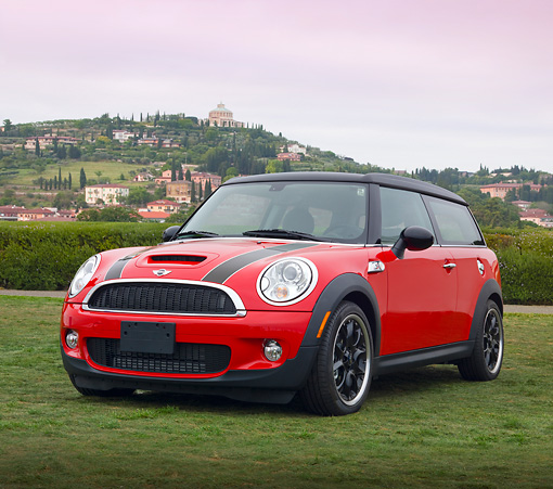 AUT 46 BK0001 01 © Kimball Stock 2013 Mini Cooper Clubman S Red With Black Stripes 3/4 Front View On Grass By Hills