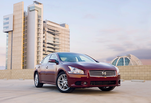 AUT 46 BK0004 01 © Kimball Stock 2011 Nissan Maxima 3.5 SV Premium Red 3/4 Front View In Parking Lot By Building