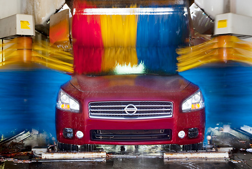 AUT 46 BK0010 01 © Kimball Stock 2011 Nissan Maxima 3.5 SV Premium Red Head On View In Car Wash