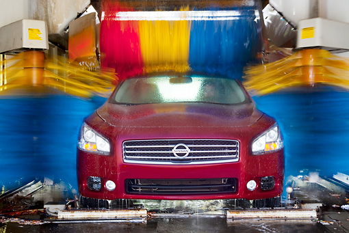 AUT 46 BK0011 01 © Kimball Stock 2011 Nissan Maxima 3.5 SV Premium Red Head On View In Car Wash