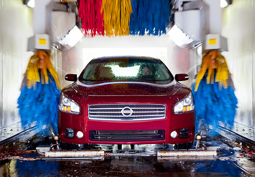 AUT 46 BK0014 01 © Kimball Stock 2011 Nissan Maxima 3.5 SV Premium Red Head On View In Car Wash