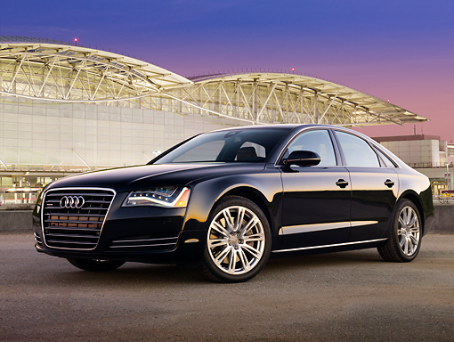 AUT 46 BK0028 01 © Kimball Stock 2011 Audi A8 Black 3/4 Front View On Pavement By San Francisco International Airport At Night
