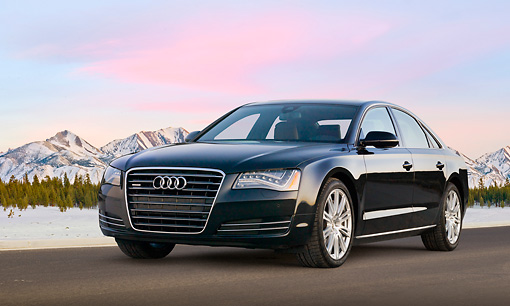 AUT 46 BK0030 01 © Kimball Stock 2011 Audi A8 Black 3/4 Front View On Pavement By Snowy Mountains