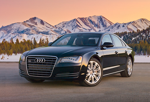 AUT 46 BK0031 01 © Kimball Stock 2011 Audi A8 Black 3/4 Front View On Pavement By Snowy Mountains At Dusk