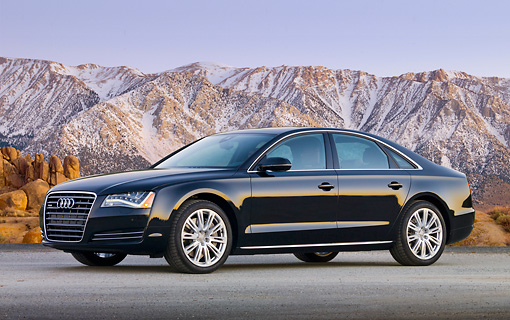AUT 46 BK0032 01 © Kimball Stock 2011 Audi A8 Black 3/4 Side View On Pavement By Snowy Mountains