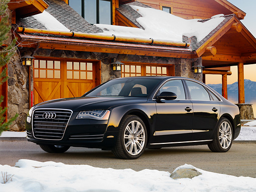 AUT 46 BK0035 01 © Kimball Stock 2011 Audi A8 Black 3/4 Front View On Pavement By Snowy Cabin
