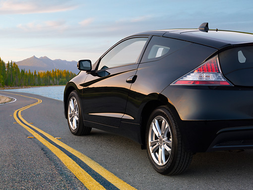 AUT 46 BK0038 01 © Kimball Stock 2011 Honda CR-Z Black 3/4 Rear View On Road By Mountains And Lake