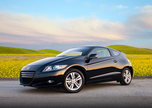 AUT 46 BK0041 01 © Kimball Stock 2011 Honda CR-Z Black 3/4 Front View On Pavement By Field Of Wildflowers