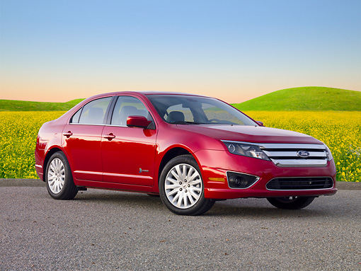 AUT 46 BK0044 01 © Kimball Stock 2011 Ford Fusion Hybrid Red 3/4 Front View On Pavement By Field Of Wildflowers