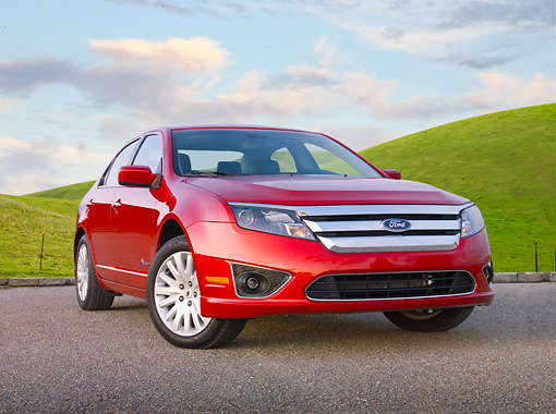 AUT 46 BK0046 01 © Kimball Stock 2011 Ford Fusion Hybrid Red 3/4 Front View On Pavement By Grassy Hills