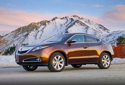 AUT 46 BK0053 01 © Kimball Stock 2011 Acura ZDX Burnt Orange 3/4 Front View On Pavement By Snowy Mountains