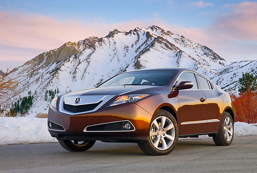 AUT 46 BK0054 01 © Kimball Stock 2011 Acura ZDX Burnt Orange 3/4 Front View On Pavement By Snowy Mountains