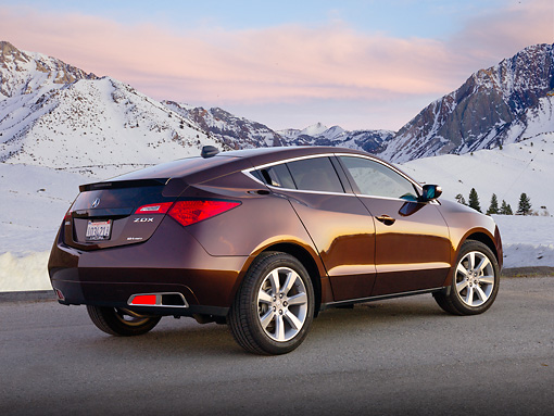 AUT 46 BK0055 01 © Kimball Stock 2011 Acura ZDX Burnt Orange 3/4 Rear View On Pavement By Snowy Mountains