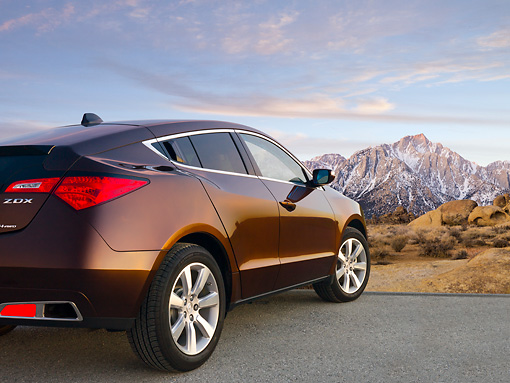 AUT 46 BK0056 01 © Kimball Stock 2011 Acura ZDX Burnt Orange 3/4 Rear View On Pavement By Snowy Mountains
