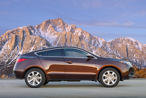 AUT 46 BK0057 01 © Kimball Stock 2011 Acura ZDX Burnt Orange Profile View On Pavement By Snowy Mountains