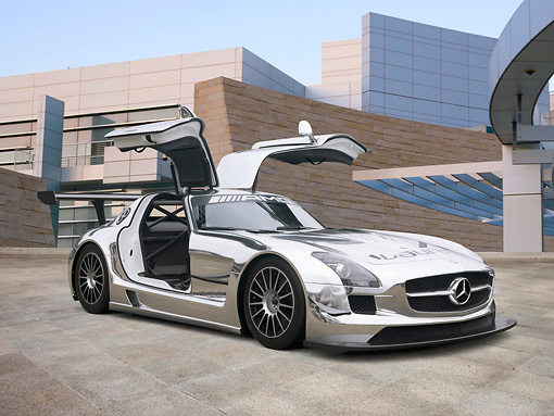 AUT 46 RK0013 01 © Kimball Stock 2011 Mercedes-Benz SLS AMG GT3 Chrome 3/4 Front View On Pavement By Building