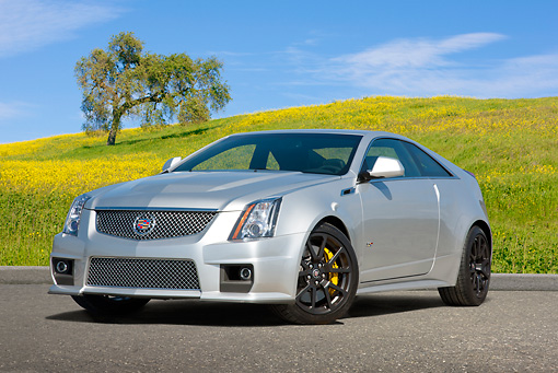 AUT 46 RK0026 01 © Kimball Stock 2011 Cadillac CTS Silver 3/4 Front View On Pavement By Grassy Hills