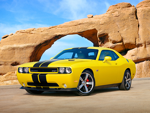 AUT 46 RK0032 01 © Kimball Stock 2011 Dodge Challenger SRT8 Yellow With Black Stripe 3/4 Front View On Beach