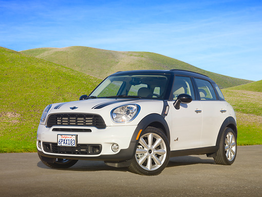 AUT 46 RK0044 01 © Kimball Stock 2011 Mini Countryman White 3/4 Front View On Pavement By Grassy Hills