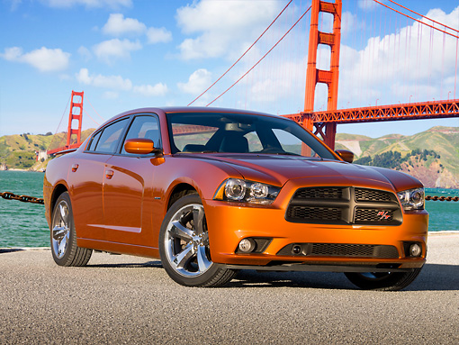 AUT 46 RK0057 01 © Kimball Stock 2011 Dodge Charger RT Orange 3/4 Front View On Pavement By Golden Gate Bridge