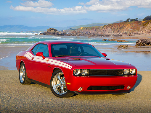 AUT 46 RK0072 01 © Kimball Stock 2011 Dodge Challenger Red 3/4 Front View On Pavement By Beach